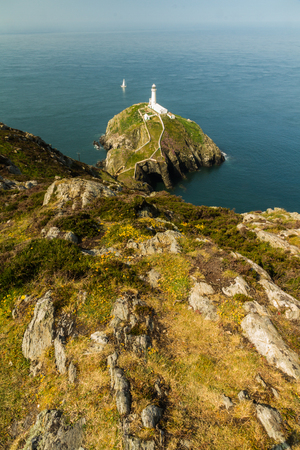 View down on South Stack light house on sunny morning. Anglesey, North Wales, United Kingdom.