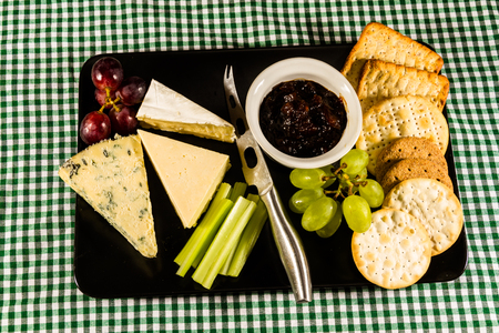 stilton: Large cheeseboard with brie, cheddar, stilton, grapes, red onion chutney, celery and crackers.