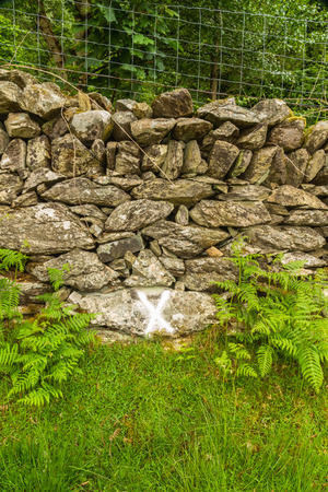 wales: After a powder oil explosion 1869 wheel and harness found by this wall, X marks this Cwm y Glo, Llanberis, Wales, United Kingdom.