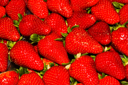 Italian red strawberries or Fragaria  piled on market stall. Stock Photo