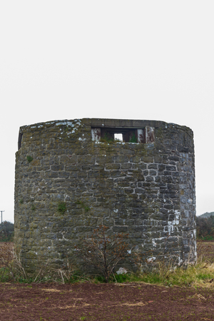Former windmill with loopholes for anti-invasion defence. Angle, Pembrokeshire, Wales, United Kingdom. Stock Photo