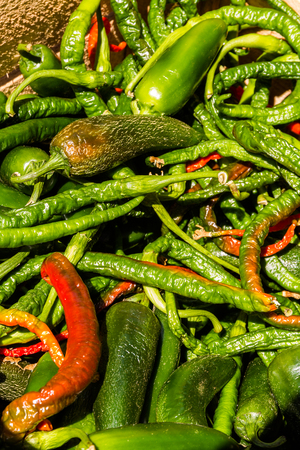 Chilli peppers in a pile making a background. Stock Photo