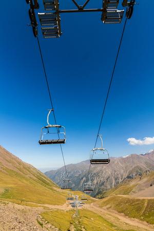 Ski lift with mountains in Summer. Shymbulak Ski Resort Hotel in Almaty, Kazakhstan, Asia. Stock Photo