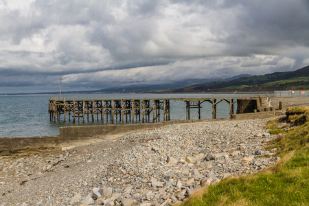 The derelict wooden pier at Trefor, llyn Peninsula, North Wales, UK