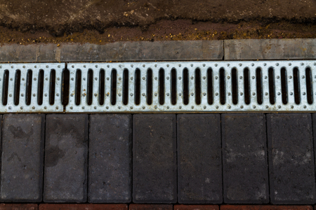 Drainage Channel with grid to drainage of driveway area Stock Photo
