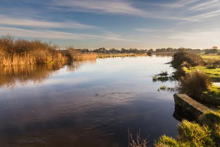 Morning light over River Avon, Christchurch, Dorset, England, UK 写真素材