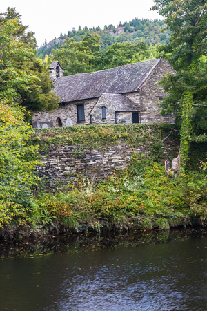 View of St Michaels Old Church from across the river Conwy, Betws-y-Coed, Gwynedd, North Wales, UK