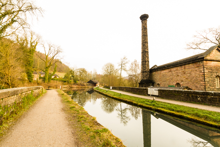 Leawood beam engine pump house, and Cromford Canal, Peak District, Derbyshire, England, UK. Editorial