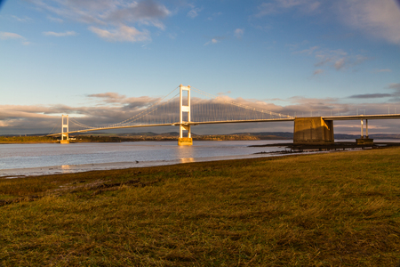 The old Severn Crossing (welsh Pont Hafren) bridge that crosses from England to Wales across the rivers Severn and Wye. Morning light.