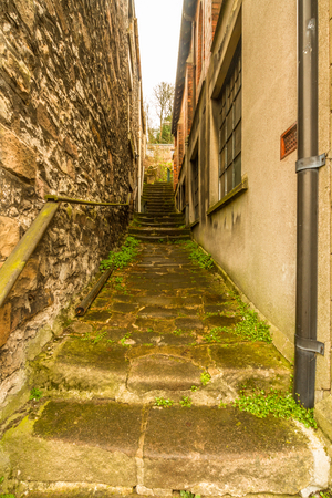 Path between old buildings with stone steps.