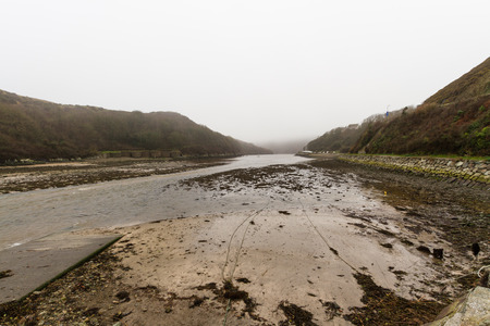 Solva, looking to see at dusk with light mist. St Brides Bay, Pembrokeshire, Wales, UK