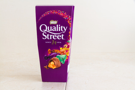 Illustrative editorial of a carton of Nestle Quality Street sweets, with copyspace – Bournemouth, United Kingdom – June 15th, 2018