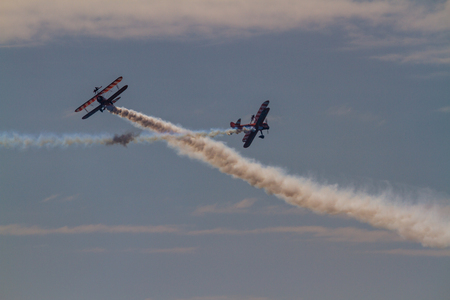 Bournemouth, United Kingdom – Bournemouth Air Festival 2018 The Aero SuperBatics Wingwalkers two areoplanes crossing on September 2 2018 in Bournemouth. Editorial