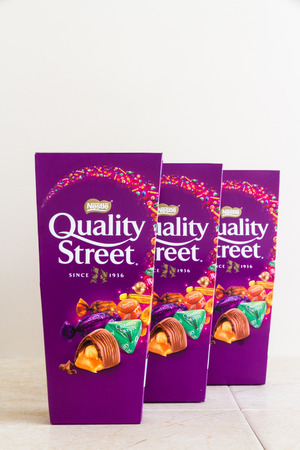 Illustrative editorial of three cartons of Nestle Quality Street sweets, with copyspace – Bournemouth, United Kingdom – June 15th, 2018