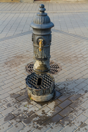 Old public water tap pr faucet in Hungary