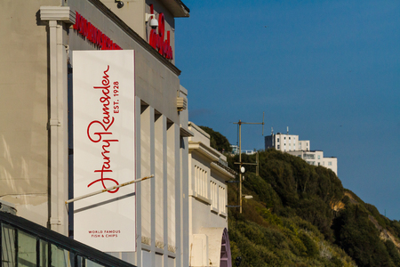 Bournemouth, United Kingdom  – Sign for Harry Ramsden Fish and Chips Restaurant  September 29 2018 in United Kingdom.