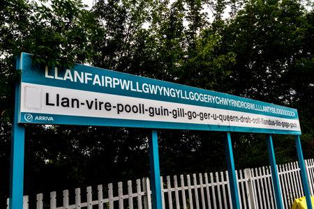 Llanfair , Wales – August 27 Arriva Trains Station Platform sign for llanfairpwllgwyngyllgogerychwyrndrobwllllantysiliogogogoch on August 27 2018 in Wales.