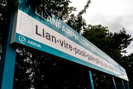 Llanfair , Wales – August 27 Arriva Trains Station Platform sign for llanfairpwllgwyngyllgogerychwyrndrobwllllantysiliogogogoch on August 27 2018 in Wales. Editorial