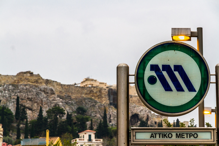 Athens, Greece – October 27, 2018:  Athens Metro sign with Parthenon out of focus in background. Editorial