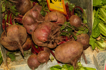 Large bunch of beetroot on market stall.