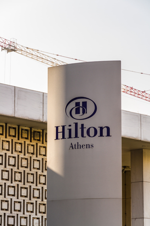 Athens, Greece – October 24 Sign or logo for the Hilton Athens Hotel on October 24 2018 in Greece. Editorial
