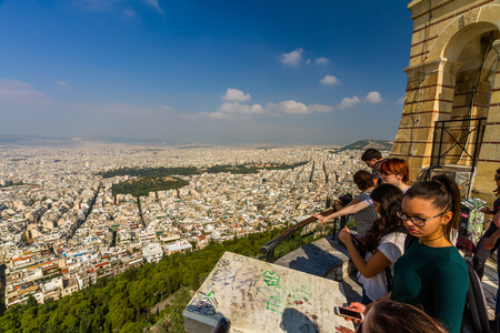Athens, Greece � October Mount Lycabettus Viewing Area and Church of St George with tourists on October 24 2018 in Greece.
