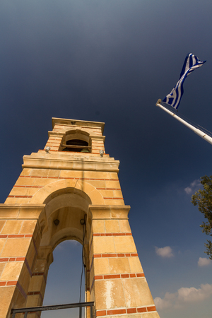 Athens, Greece – October 24 The Bell Tower on Mount Lycabettus Viewing Area with Greek flag on October 24 2018 in Greece. Editorial
