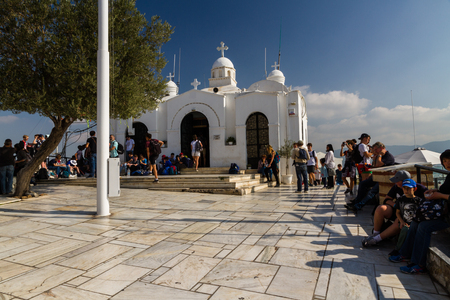 Athens, Greece – October Mount Lycabettus Viewing Area and Church of St George with tourists on October 24 2018 in Greece.