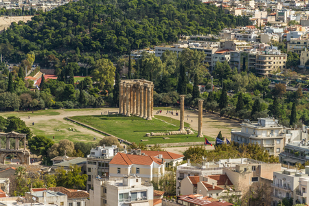 City scape of Athens in Greece, with Temple of Olympian Zeus from the Acropolis. Imagens