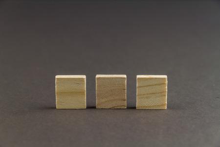 Three wood blocks against dark background, graphic resource, template, landscape, macro