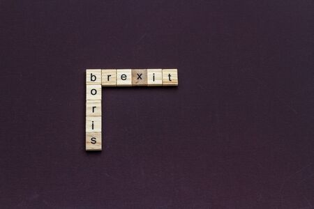 Boris and Brexit, like a crossword, in children letter blocks, landscape, copyspace