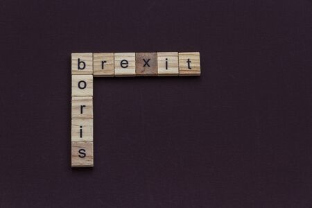 Boris and Brexit, like a crossword, in children letter blocks, landscape