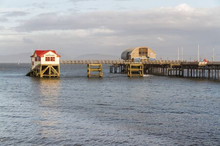 Old and new lifeboat station, The Mumbles, Swansea, Wales, afternoon light