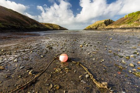 Abercastle Harbour, Pembrokeshire, Wales, UK, wide angle, landscape with red buoy.