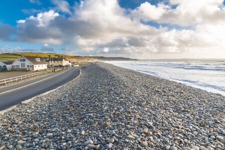 View along Newgale beach with some of village, Pembrokeshire, West Wales. Imagens