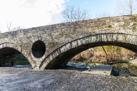 Arch of old Cenarth Bridge, Newcastle Emlyn, Carmarthenshire, Wales, UK