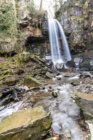 Melincourt Water Fall in full February flow, portrait, wide angle.