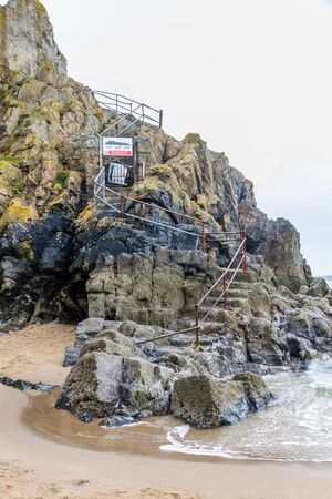 Tenby, Wales – Steps up to the closed St Catherines Island, on February 18 2019 in Wales Editorial