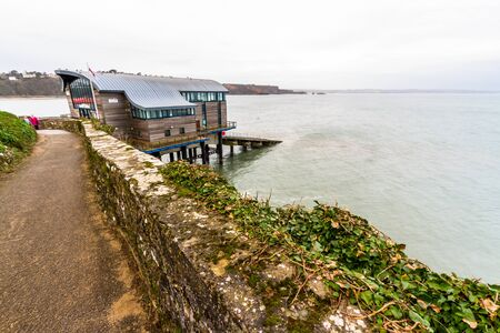 Tenby, Wales – Path and new lifeboat Station, on February 18 2019 in Wales