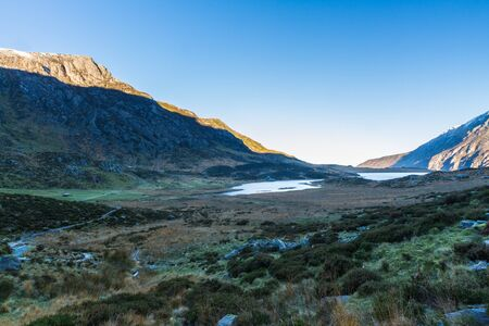 Morning light over Com and lake Idwal. Snowdonia national Park, Gwynedd, Wales, UK. landscape