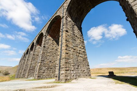 Sunny day close to the sunlit arches of the Ribblehead Viaduct, landscape. North Yorkshire, Europe, England, landscape and wide angle. Фото со стока