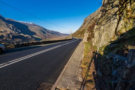 Uk road A5 at Nant Ffrancon Pass, Bethesda. Snowdonia national Park, Gwynedd, Wales, UK. Landscape, wide angle.