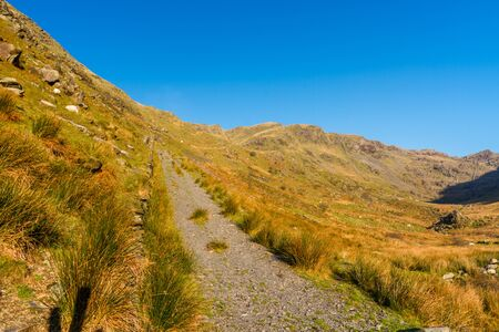 Beautiful Day in Winter Autumn Fall and copyspace in blue sky and remains of Croesor Tramway and Blaen y Cwm incline, Snowdonia national Park, Gwynedd, Wales, UK, Landscape Фото со стока