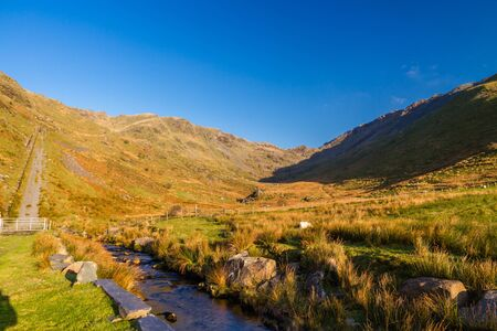 Beautiful Day in Winter Autumn Fall with stream. Cwm Croesor Valley Snowdonia national Park, Gwynedd, Wales, UK, Landscape, wide, angle