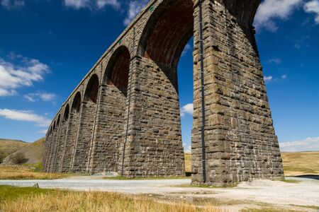 Sunny day close to the arches of the Ribblehead Viaduct, landscape. North Yorkshire, Europe, England, landscape.