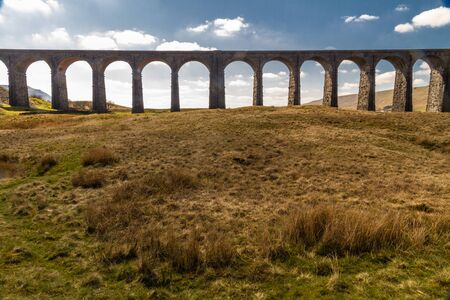 Arches against blue sky and cloud of the Ribblehead Viaduct, landscape. North Yorkshire, Europe, England, landscape