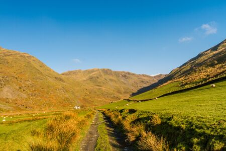 Beautiful Day in Winter Autumn Fall and copyspace in blue sky and remains of Croesor Tramway. Head of Cwm Croesor Valley and mountain Cnicht, Snowdonia national Park, Gwynedd, Wales, UK, Landscape