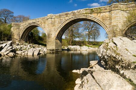 Looking up at Devils Bridge, over the River Lune. Kirkby Lonsdale, Cumbria, England, landscape.