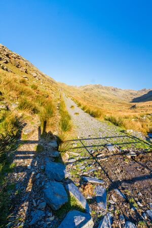 Beautiful Day in Winter Autumn Fall and copyspace in blue sky and remains of Croesor Tramway and Blaen y Cwm incline, Snowdonia national Park, Gwynedd, Wales, UK, portrait, copyspace at top blue sky