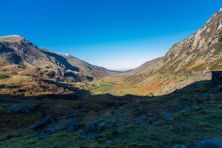 Morning sun on valley, Nant Ffrancon Pass, Snowdonia national Park, Gwynedd, Wales, UK. Landscape, wide angle.